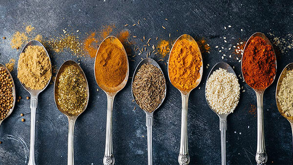 image shows spoons full of different spices and ingredients
