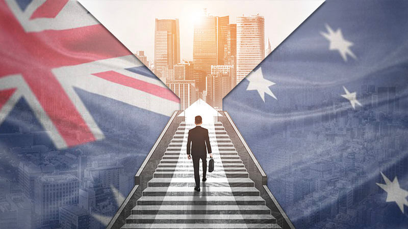 images hows businessman walking up stairs towards a city with australian flag in background